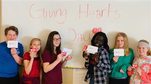 Students holding Gift Cards